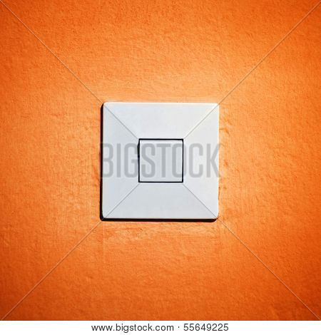 Vintage Light Switch On Orange Wall