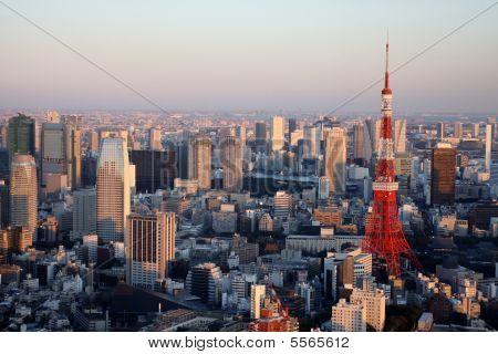 Tokyo Tower Amidst Other Skyskrapers At Dusk