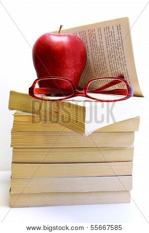 Stack Of Books With Apple And Eyeglasses Isolated