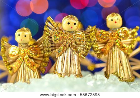 christmas decoration, choir of angels against bokeh background