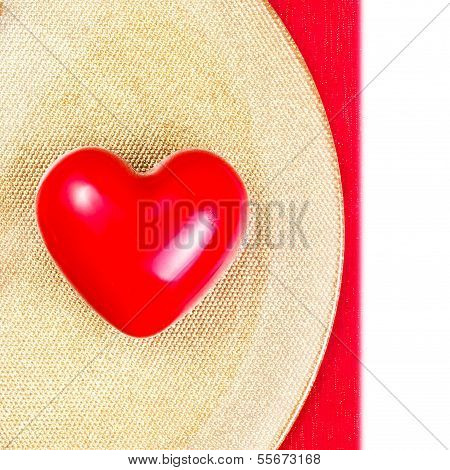 Red Heart Over Golden Plate On Red Tablecloth Isolated On White Background. Valentines Day Backgroun