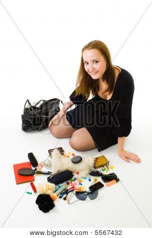 Woman With Accessories From Woman Handbag