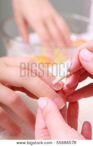 Beautician Cleaning Cuticles Hands Female Client. Beauty Salon.