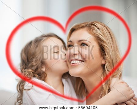 family, children and love concept - hugging mother and daughter
