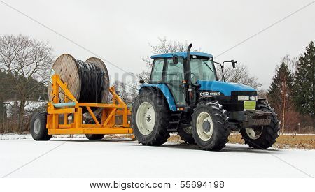 New Holland 8160 Tractor With Power Cable On Trailer