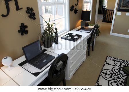 Residential office with laptops