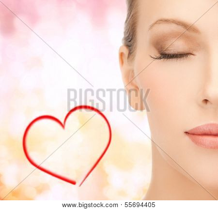 healt, spa and beauty concept - close up of face of beautiful young woman