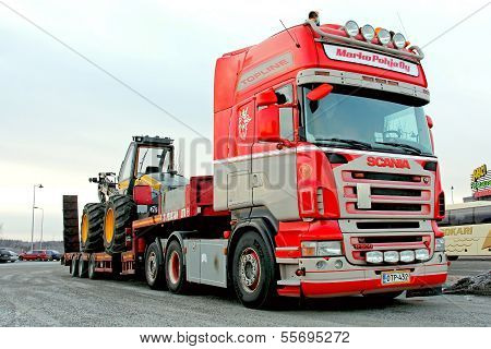 Scania Truck Hauling A Forest Harvester