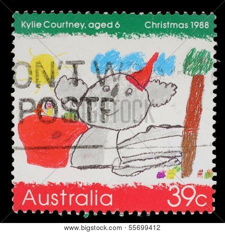 AUSTRALIA - CIRCA 1988: a stamp printed in the Australia shows Koala Wearing a Santa Hat, by Kylie Courtney, Childrens Design, Christmas, circa 1988