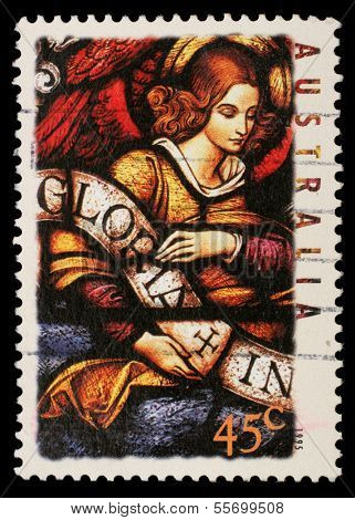 AUSTRALIA - CIRCA 1995: A stamp printed in Australia shows Angel with Gloria in excelsis Deo Banner, circa 1995