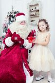 picture of saint-nicolas  - Saint Nicolas gives Christmas gifts to the little girl - JPG