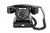 pic of rotary dial telephone  - An old black vintage rotary style telephone isolated over a white background - JPG