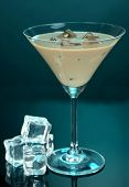 stock photo of bailey  - Baileys liqueur in glass on blue background - JPG