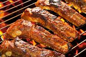 stock photo of ribs  - Grilled pork spare ribs on the grill - JPG