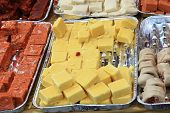 stock photo of gulab  - The indian sweets for sale at a market - JPG