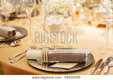 Elegant Table Set In Soft Creme For Wedding Or Event Party.