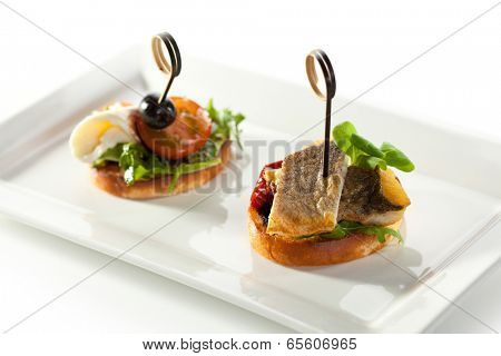 Fish and Vegetables Canapes over White