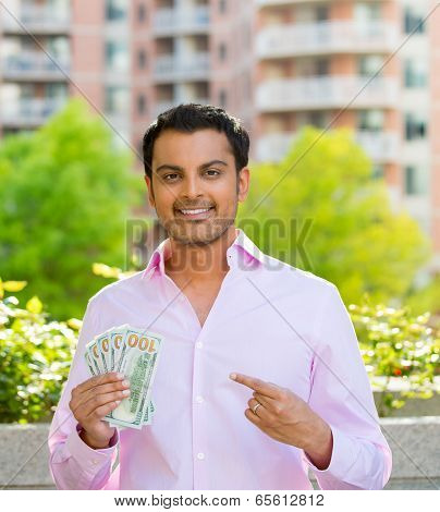 businessman pointing to money