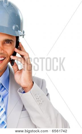 Close-up Of An Architect With A Hardhat On Phone