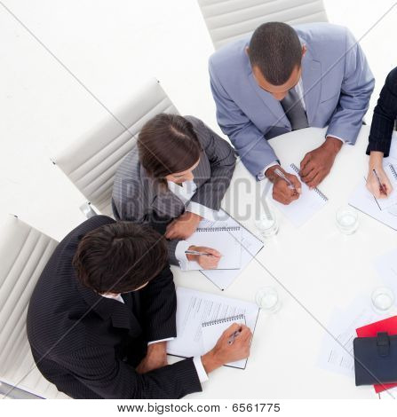 High Angle Of An International Young Business People Discussing A New Strategy