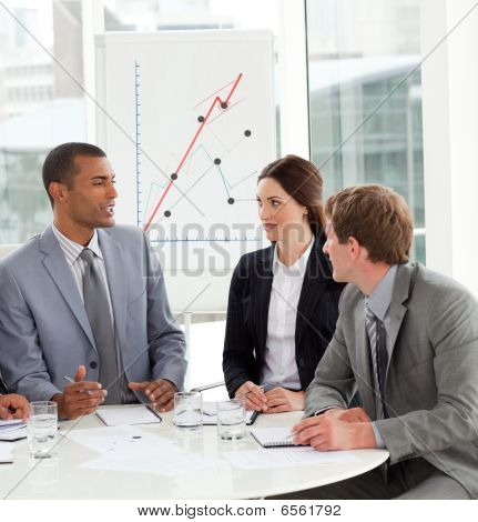 Manager And His Team Discussing A New Strategy