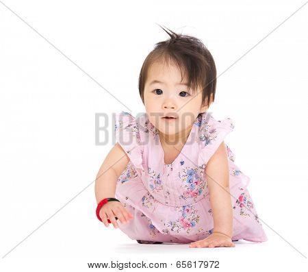 Adorable little baby girl creeping on floor