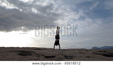Man Handstands At On Rocks Of Ko Olina