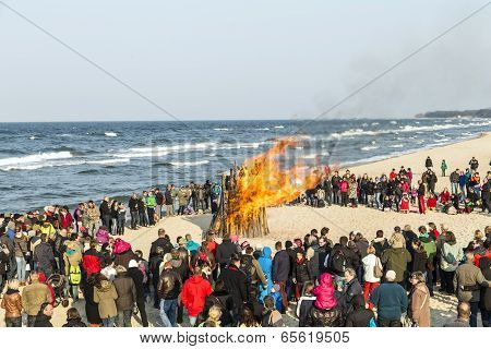 People Watch The Easter Fire At The Beach