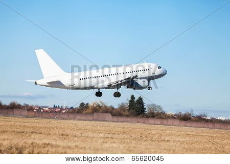 Passenger Airliner Taking Off At An Airport