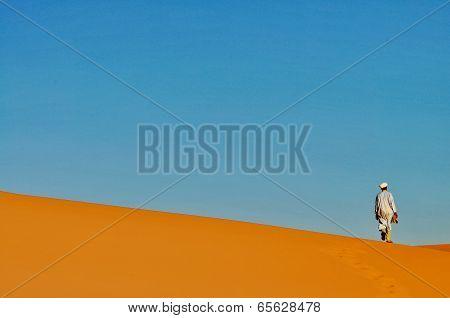 Merzouga Desert - October 01: Man In Traditional Berber Wear, Walking In Merzouga Desert, Morocco On