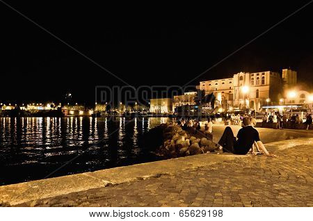 Riva Del Garda boardwalk by night - Italy