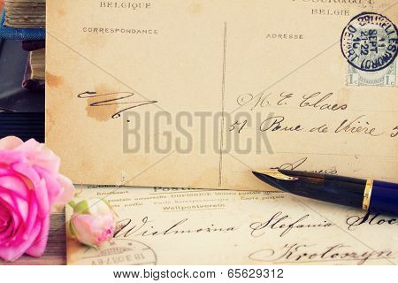 antique empty postcard with flowers and quill pen