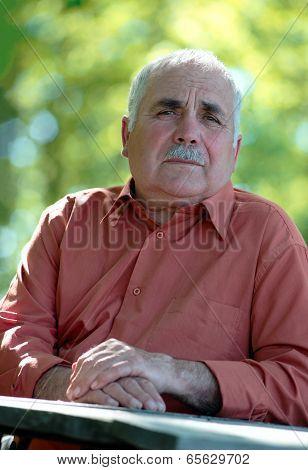 Portrait Of A Wistful Sad Senior Man