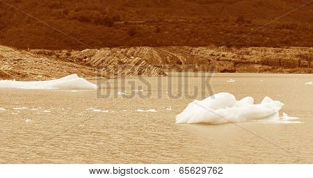Patagonian Landscape With Icebergs In Warm Tone