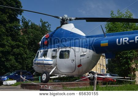 KIEV, UKRAINE - MAY 26, 2014: The monument of helicopter Mi-2 (Codling) near technical laboratories of National Polytechnic University on May 26, 2014 in Kiev, Ukraine
