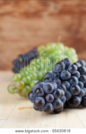 Blue And Green Grape Clusters