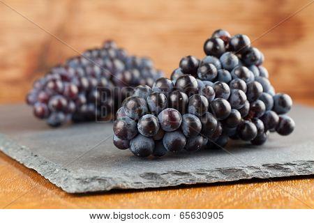 Blue Grape Clusters On Slate Board