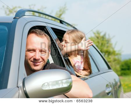 Family with kids in a car
