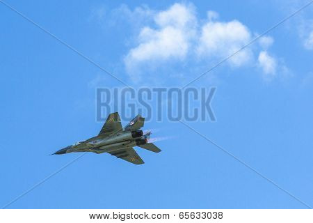 BERLIN, GERMANY - MAY 20, 2014: Jet fighter Mikojan-Gurewitsch MiG-29 (Polish Air Force) demonstration during the International Aerospace Exhibition ILA Berlin Air Show-2014.