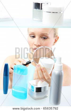 Cosmetic shopping - woman reading label