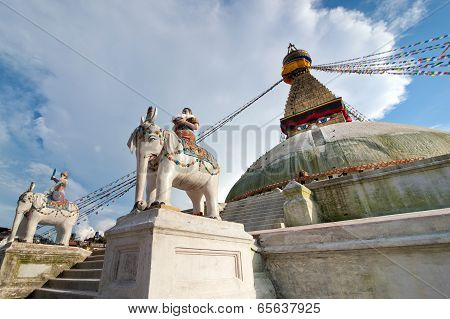 Buddhist Shrine Boudhanath Stupa With Pray Flags Over Blue Sky. Nepal, Kathmandu