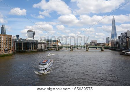 Boats Sail The River Thames In London, England