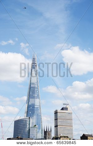 Aircraft Flying High Above The Shard In London, England