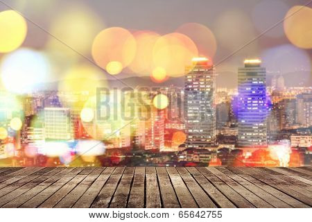 Wooden ground with city night scene and bokeh far away.