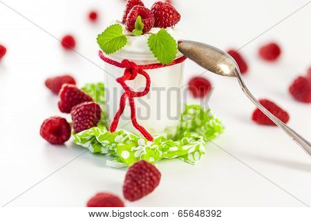 Raspberries And Yoghurt Or Clotted Cream