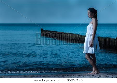 Beautiful Meditative Woman On A Moonlit Seashore