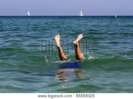 Active Boy Swimming In The Sea Water.
