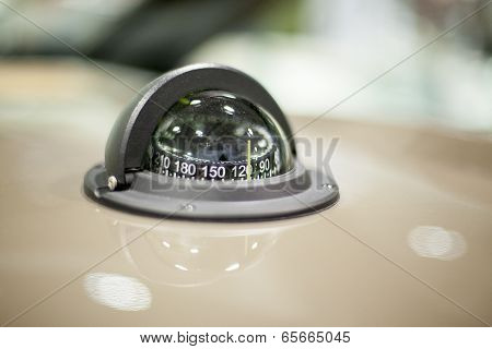 Close-up of a compass in a speedboat