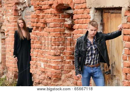 The man and woman against a wall
