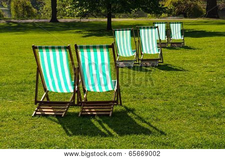 Deckchairs in a park, spring season